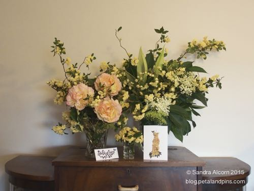 Spring floral display with a petal & pins greeting card