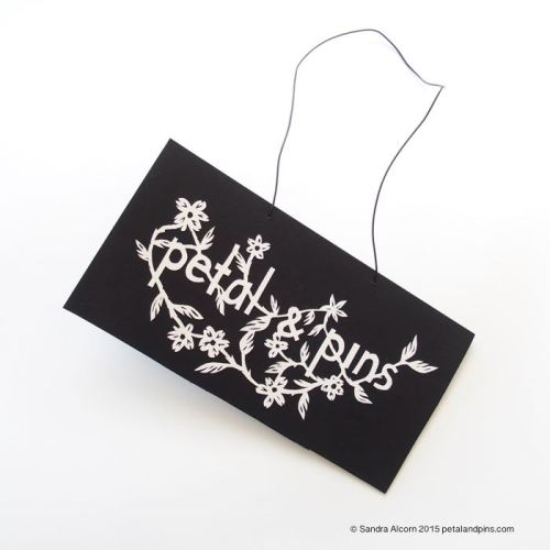 petal & pins paper cut sign