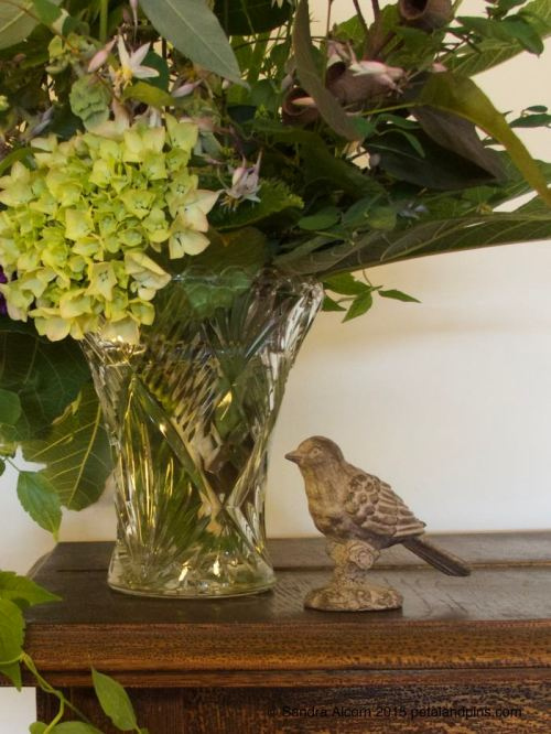 hydrangea and wooden bird